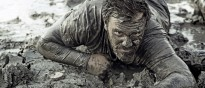Dark haired man crawling during a mud run 000074673367 Large min