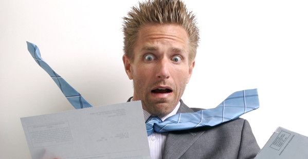 Shocked Businessman Office Worker Opening a Big Bad Bill 000005485466 Large