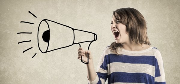 Teenage Girl shouting in a Megaphone 000051049894 Large 600x283 min