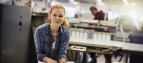 ResizedImage600267 Photo of a young woman in printing factory 000087592153 Large min